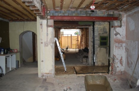 A view looking from the back of the cafe all the way through to the new shopfront frame.