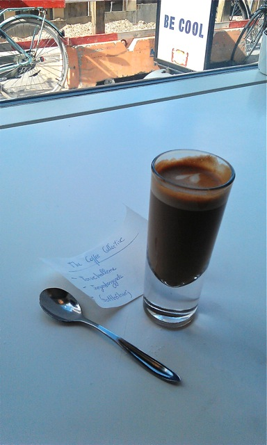 Cortado Scandi coffee served in a shot glass with heart shaped latte art