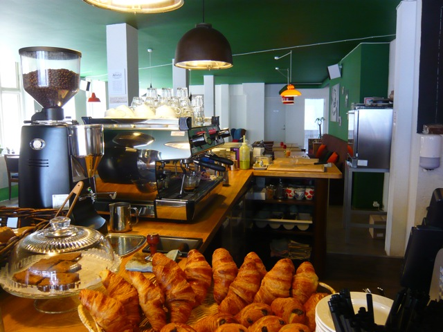 Ricco's Kaffebar counter, pastries on top, mazzer grinder, industrial lighting, Scandi Coffee