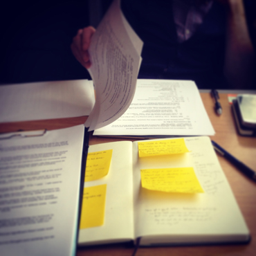Photo of post-its, moleskin and clipboard