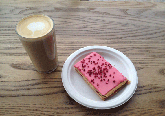 Latte and HIndbærsnitter at speciality coffee shop 'The Coffee Collective'
