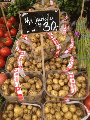 Potatoes and other produce at the Torvehallerne Artisan Food Hall in Copenhagen.