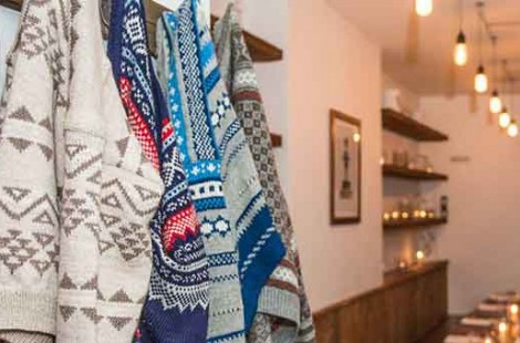 Cosy jumpers and candles in Baltzersen's Scandinavian cafe in Harrogate, an example of hygge