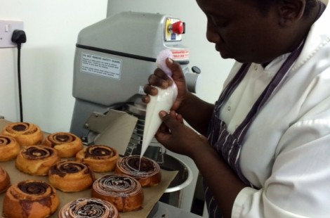 Linda takes a lot of care when icing her cinnamon buns, she wants each one to look its best