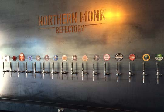 Taps on wall at Northern Monk Brew Co. Refectory - home of Indie Food company Grub and Grog Shop