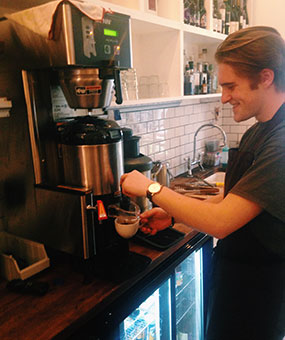 Filter coffee in Harrogate being poured by Baltzersen's Barista Niall