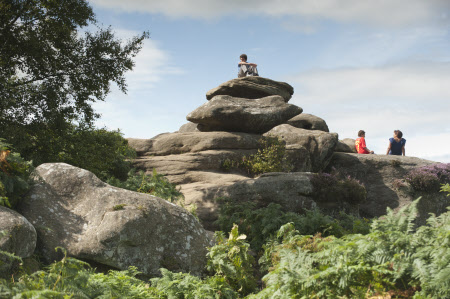 Visitors sitting at Brimham Rocks - one of many great free things to do in Harrogate!