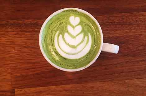 Photo of matcha latte for blog on Matcha and turmeric lattes at Baltzersen's Scandinavian cafe in Harrogate