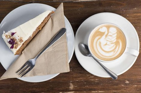 Coffee training is required to be able topper a latte art swan pictured here with a slice of carrot cake.