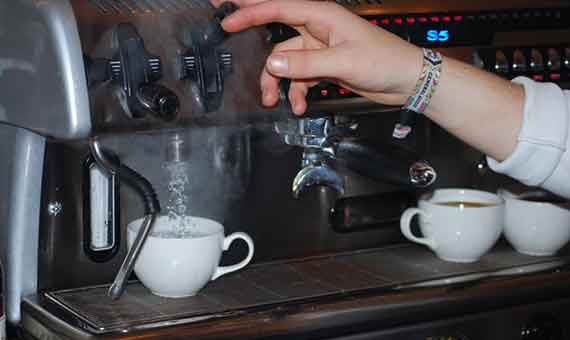 Photo of hot water being poured to make an americana at Baltzersen's Scandinavian cafe in Harrogate for their blog about americana vs batch brew coffee