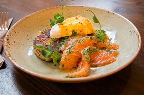 Photo of Baltzersen's dish of home cured gravlaks on a gluten free potato cake with a poached duck egg and dill sauce