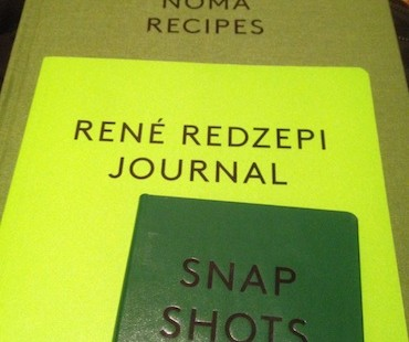 A photo of the 3 part book set 'A Work in Progress' written by Rene Redzepi of Noma, Copenhagen.