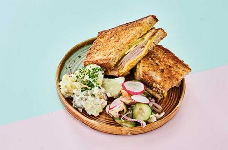 Cubano sandwich with potato salad and house pickles